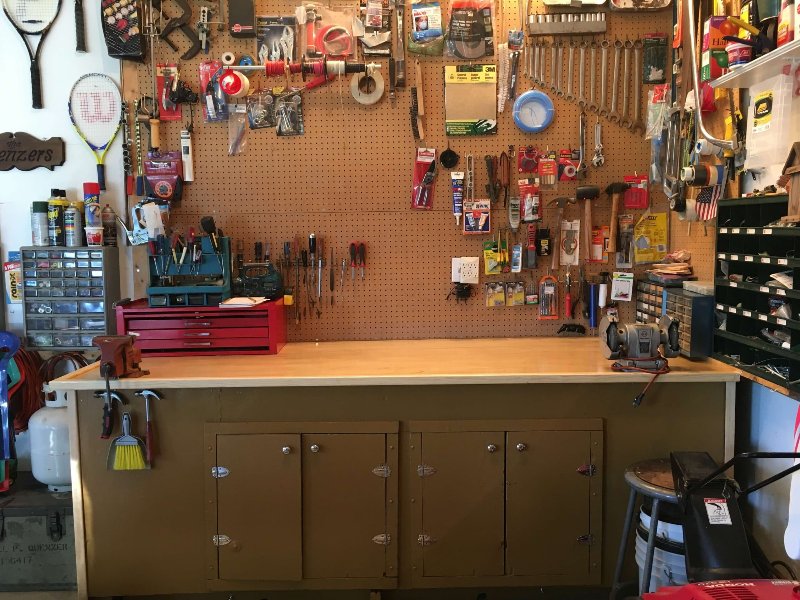 A garage workshop with a wide selection of tools
