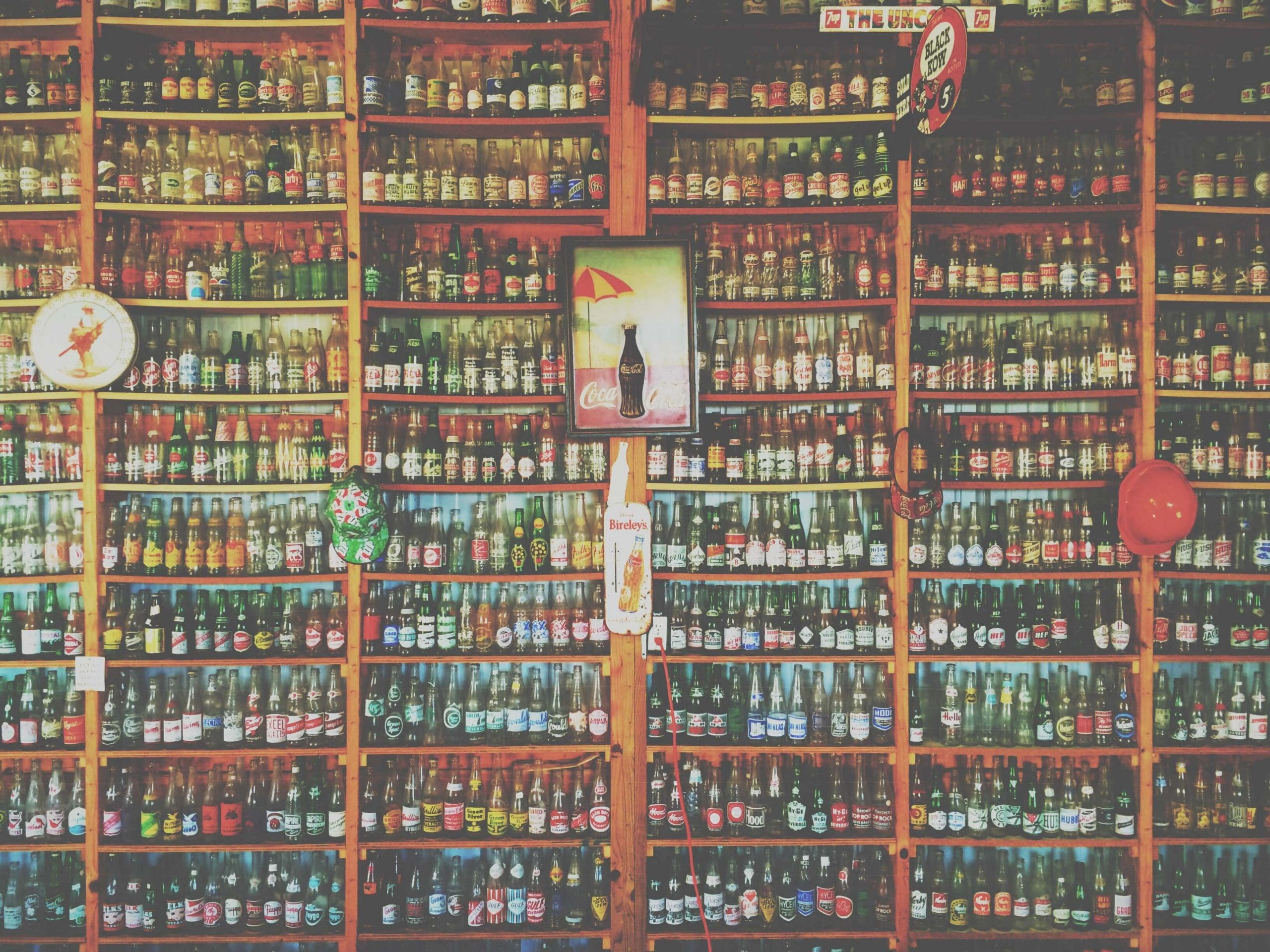 A bar shelf stacked with bottles