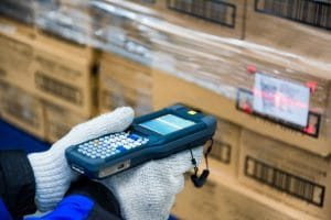 A warehouse worker scanning boxes