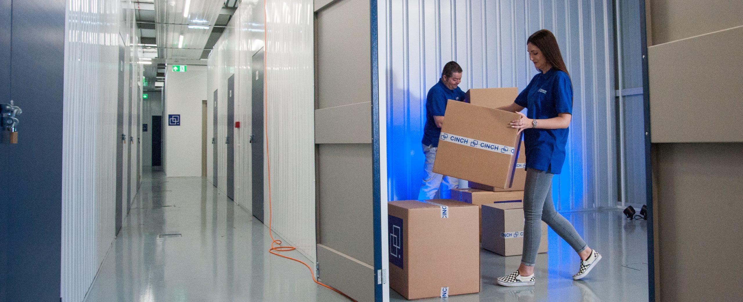 Cinch self storage staff helping customer move in