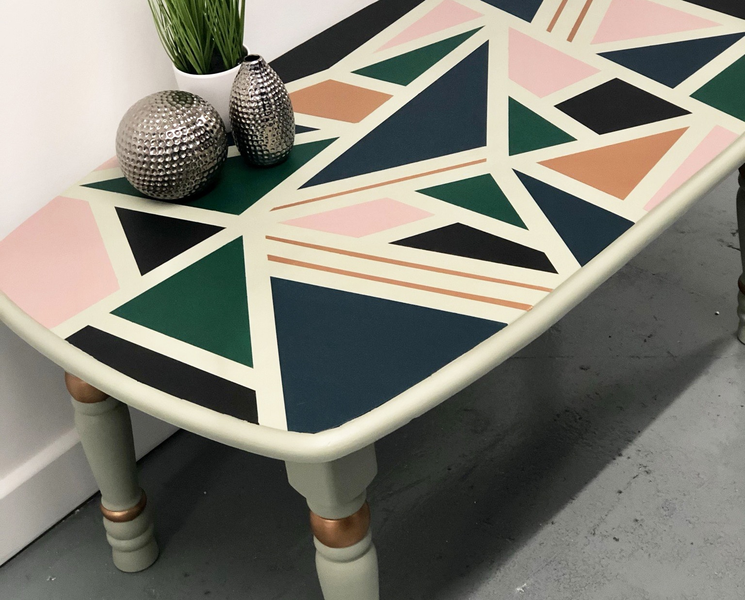 A coffee table with colourful geometric patterns