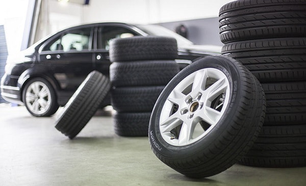 A car and car tyres in a garage