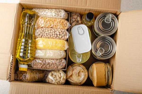 Canned goods in a cardboard box