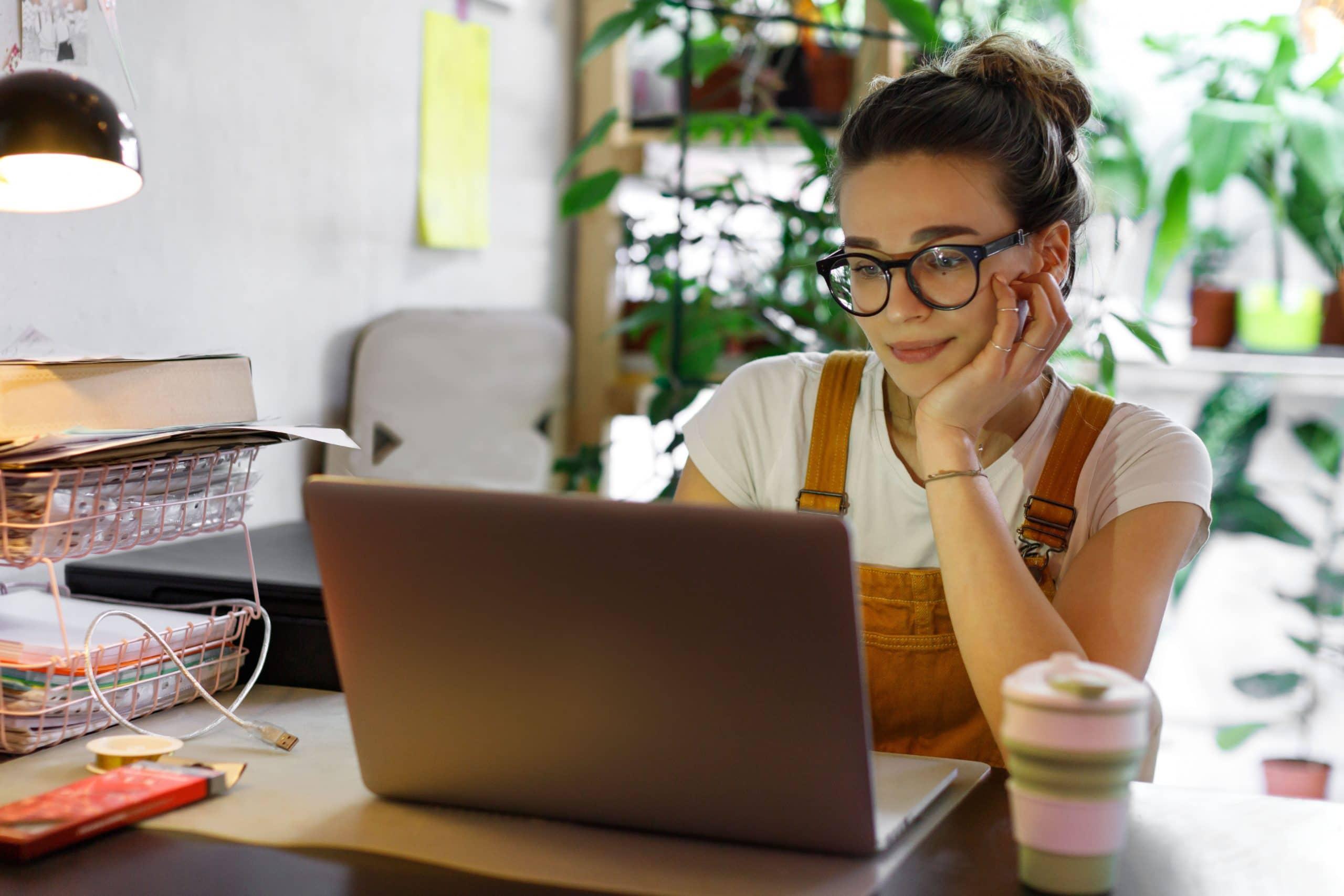 Young,Female,Gardener,In,Glasses,Using,Laptop,,Communicates,On,Internet