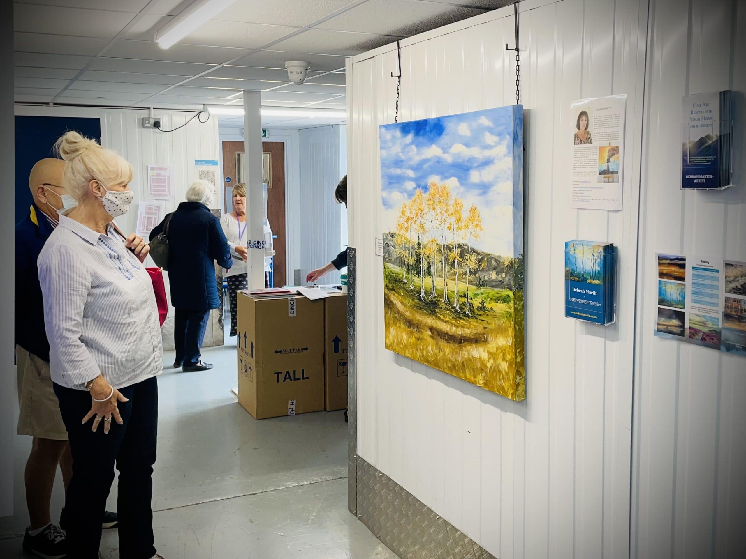 People admiring the artwork at the Bicester Art Exhibition 2021